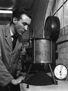 A Lab Technician Undertaking a Coal Flow Test, Mapperley Colliery, Derbyshire, 1962 by Michael Walters