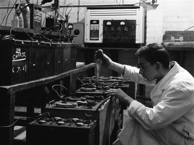 A Young Apprentice at Globe and Simpson Auto Electricians Workshop, Lincoln, Lincolnshire, 1961 by Michael Walters