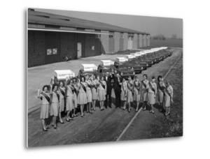 Australian Sales Girls in Front of a Fleet of 1965 Hillman Imps, Selby, North Yorkshire, 1965 by Michael Walters