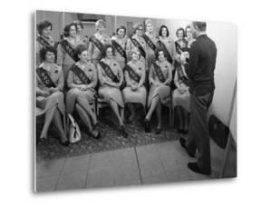 Australian Sales Girls with Spl Sashes Listen to a Sales Talk, Selby, North Yorkshire, 1965 by Michael Walters