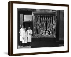 Butchers Standing Next to their Shop Window Display, South Yorkshire, 1955 by Michael Walters