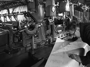 Checking Printed Pages from a Two Colour Press, Mexborough, South Yorkshire, 1959 by Michael Walters