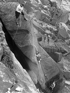 Climbers on Stanage Edge, Hathersage, Derbyshire, 1964 by Michael Walters