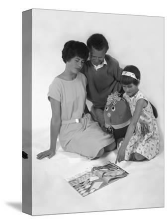 Family Group Looking at a Magazine, 1963