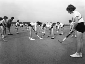 Girls Hockey Match, Airedale School, Castleford, West Yorkshire, 1962 by Michael Walters