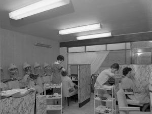 Hairdressers at Work, Armthorpe, Near Doncaster, South Yorkshire, 1961 by Michael Walters