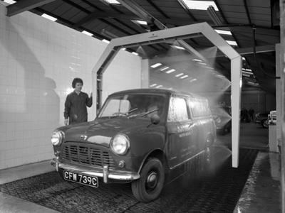 Mini Van Being Washed in a Car Wash, Co-Op Garage, Scunthorpe, Lincolnshire, 1965 by Michael Walters