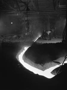 Molten Steel Being Channelled at the Stanton Steel Works, Ilkeston, Derbyshire, 1962 by Michael Walters