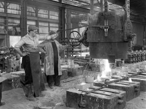 Pouring a Small Casting at Edgar Allens Steel Foundry, Sheffield, South Yorkshire, 1963 by Michael Walters