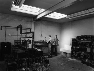 Scene in the Workshops of Globe and Simpson Auto Electricians, Lincoln, Lincolnshire, 1961 by Michael Walters