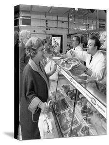 Scene Inside a Butchers Shop, Doncaster, South Yorkshire, 1965 by Michael Walters