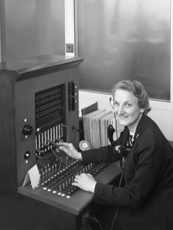 Switch Board Operator, Spillers Animal Foods, Gainsborough, Lincolnshire, 1960 by Michael Walters