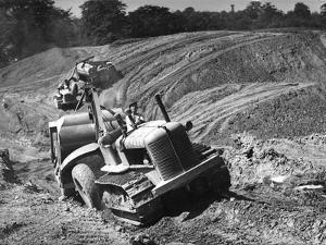 Tractor Unit Pulling an Earth Grading Machine at a Site Near Rotherham, South Yorkshire, 1954 by Michael Walters