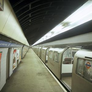 Tube Train Standing at Blackhorse Road Station on the Victoria Line, London, 1974 by Michael Walters