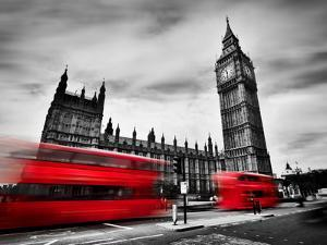 London, the Uk. Red Buses in Motion and Big Ben, the Palace of Westminster. the Icons of England In by Michal Bednarek