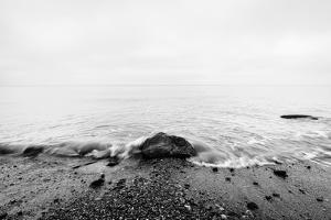 Nostalgic Sea. Waves Hitting in Rock in the Center. Black and White, far Horizon. by Michal Bednarek