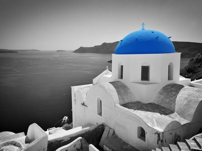 Oia Town on Santorini Island, Greece. Black and White Styled with Blue Dome of Traditional Church O