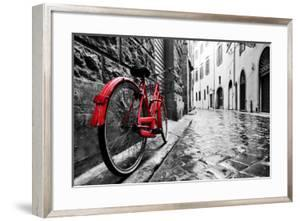 Retro Vintage Red Bike on Cobblestone Street in the Old Town. Color in Black and White. Old Charmin by Michal Bednarek