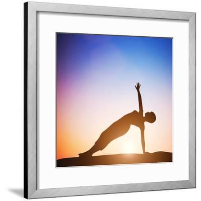 Woman in Side Balance Yoga Meditating at Sunset. Zen