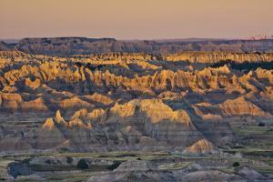 Illuminated Buttes, Sunrise, Pinnacles Viewpoint, Badlands National Park, South Dakota, Usa by Michel Hersen