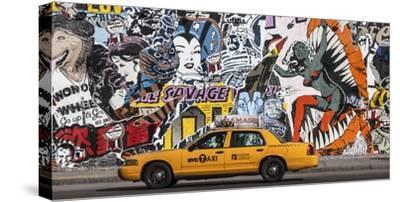 Taxi and mural painting in Soho, NYC