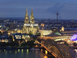 Germany, North Rhine Westphalia, Cologne (Koln), Hohenzoller Bridge over River Rhine and Cathedral by Michele Falzone