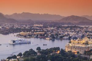 India, Rajasthan, Udaipur, Elevated View of Lake Pichola and Udaipur City by Michele Falzone