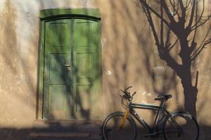 Argentina, Salta, Valles Calchaquies. Shadowed Bike by Green Door by Michele Molinari