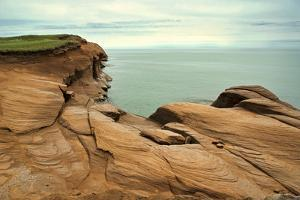 Canada, Quebec, Iles-de-la-Madeleine. Red cliffs and ocean by Michele Molinari