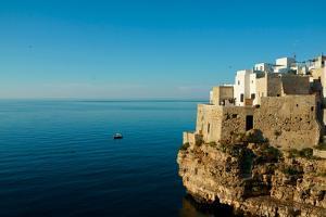 Italy, Apulia, Polignano a Mare. Old village over the cliff. by Michele Molinari