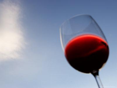 Red Wine Glass Against a Blue Sky, Paris, France