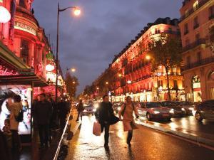 Shoppers along Boulevard Haussmann, Paris, France by Michele Molinari