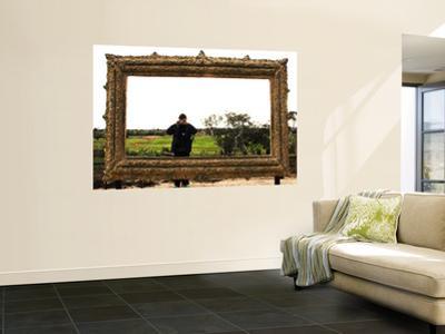 Man Taking Photo Inside Giant Frame Overlooking Werribee Open Range Zoo
