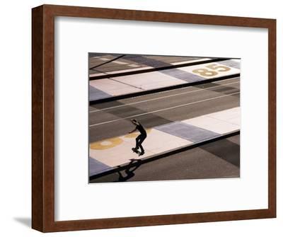 Teenage Boy Skateboarding on Road, Docklands