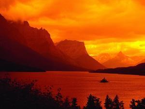 Sunset Over Lake in Glacier National Park by Mick Roessler