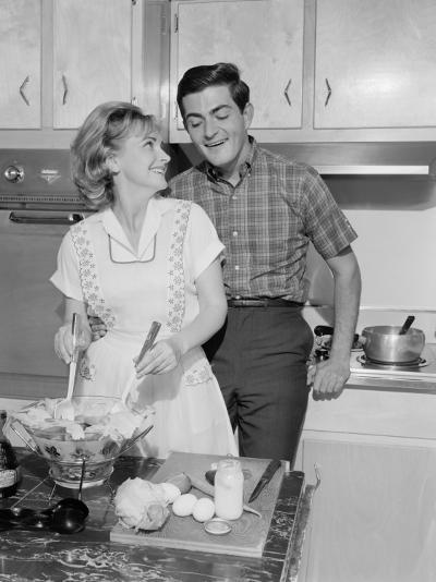 Mid Adult Couple in Kitchen, Woman Preparing Salad-George Marks-Photographic Print