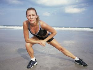 Mid Adult Woman Doing Aerobics on the Beach