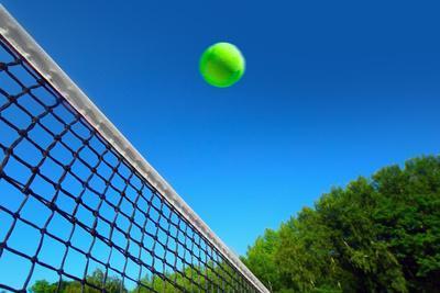 Tennis Ball on Net's Edge