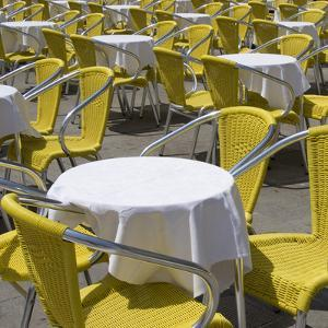 Sense of Place, Venice, Piazza San Marco, Saint Marks' Square. Round Cafe Tables with Yellow Chairs by Mike Burton