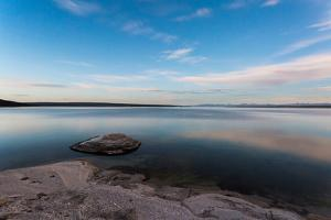 Fishing Cone Jutting Out Into Yellowstone Lake Below Stars, Yellowstone National Park, Wyoming by Mike Cavaroc