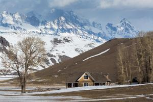 Snow Melting Around The Historic Miller House Below The Teton Mts. National Elk Refuge, Wyoming by Mike Cavaroc