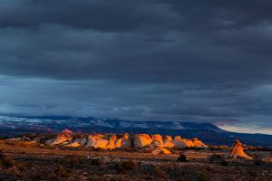 Storm Clouds, Sandstone Outcropping Near The Windows Section, Warm Sunset Light. Arches NP, Utah by Mike Cavaroc