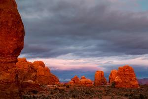 Sunset Light Causing Sandstone To Appear To Be Glowing Near The Windows Section. Arches NP, Utah by Mike Cavaroc