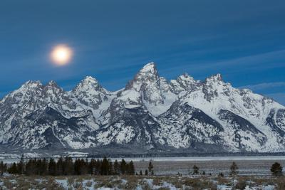 The Full Moon Sets Above The Teton Mountains And Jackson Hole, Wyoming