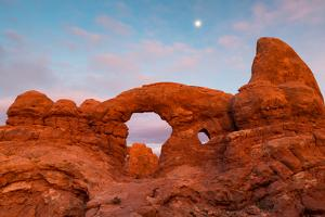 The Moon Rising Above Turret Arch At The Windows Section. Arches National Park, Utah by Mike Cavaroc
