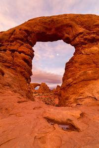 The Moon Rising Through Turret Arch Above The North Window At The Windows Section. Arches NP, Utah by Mike Cavaroc