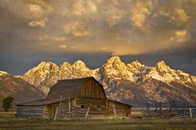 The Moulton Barn on Mormon Row Stands before a Fiery Sunrise in Grand Teton National Park, Wyoming