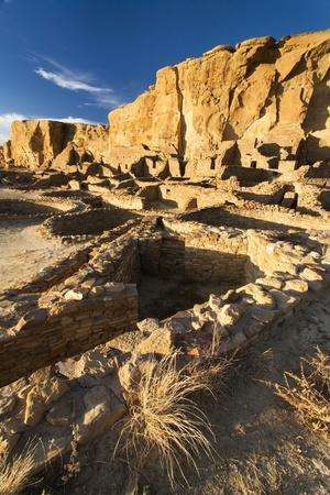 The Pueblo Bonito Ruins Lie At The Base Of The Chaco Canyon Walls In Chaco Culture NHP, New Mexico