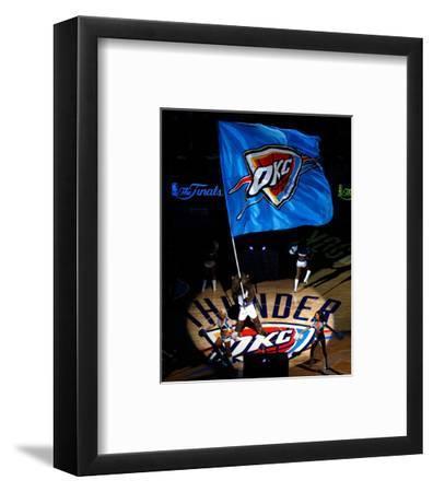 Oklahoma City, OK - June 12: The Oklahoma City Thunder mascot waves a flag at center court