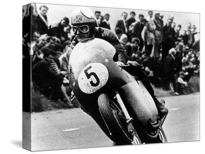 Mike Hailwood, on an Mv Agusta, Winner of the Isle of Man Senior TT, 1964